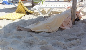 ATTENTION EDITORS - VISUAL COVERAGE OF SCENES OF DEATH AND INJURY  The body of a tourist shot dead by a gunman lies near a beachside hotel in Sousse, Tunisia June 26, 2015. At least 27 people, including foreign tourists, were killed when at least one gunman opened fire on the Tunisian beachside hotel in the popular resort of Sousse on Friday, an interior ministry spokesman said. Police were still clearing the area around the Imperial Marhaba hotel and the body of one gunman lay at the scene with a Kalashnikov assault rifle after he was shot in an exchange of gunfire, a security source at the scene said. REUTERS/Amine Ben Aziza