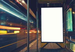 Mock up banner of bus station public, information board with blurred vehicles in high speed in night city