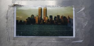 Picture of World Trade Center towers is seen outside New York Fire Department Engine Company and Ladder Company 10 near the 9/11 Memorial site in New York