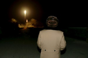 North Korean leader Kim Jong Un watches the ballistic rocket launch drill of the Strategic Force of the Korean People's Army (KPA) at an unknown location, in this undated photo released by North Korea's Korean Central News Agency (KCNA) in Pyongyang on March 11, 2016.