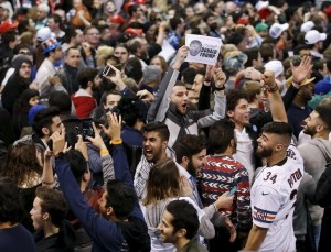 Demonstrators cheer after Republican U.S. presidential candidate Donald Trump cancelled his rally at the University of Illinois at Chicago March 11, 2016. REUTERS/Kamil Krzaczynski