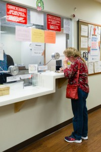 Eileen Bachemin, 50, signs in for her appointment at the San Fernando Mental Health Center in Granada Hills, Calif., on Monday, February 8, 2016. (Heidi de Marco/KHN)