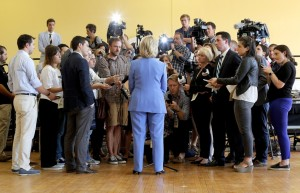 Democratic presidential candidate Clinton answers questions from reporters following a campaign town hall meeting in Dover