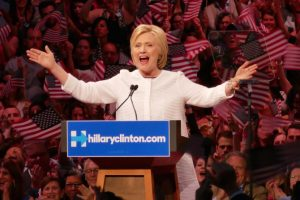Clinton claims nomination as primaries near end