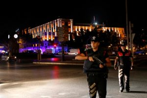 Police officers stand guard near the Turkish military headquarters in Ankara