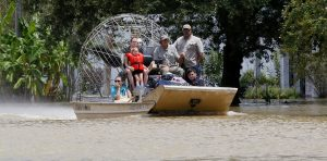 An airboat brings rescued residents to safety in Ascension Parish