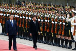 President of the Philippines Rodrigo Duterte and Chinese President Xi Jinping review the guard of honors as they attend a welcoming ceremony at the Great Hall of the People in Beijing