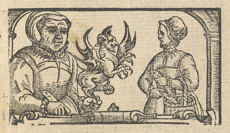 a witch, writing at a table and holding a demon in her left hand, while another woman carries a basket of fish and looks on nervously
